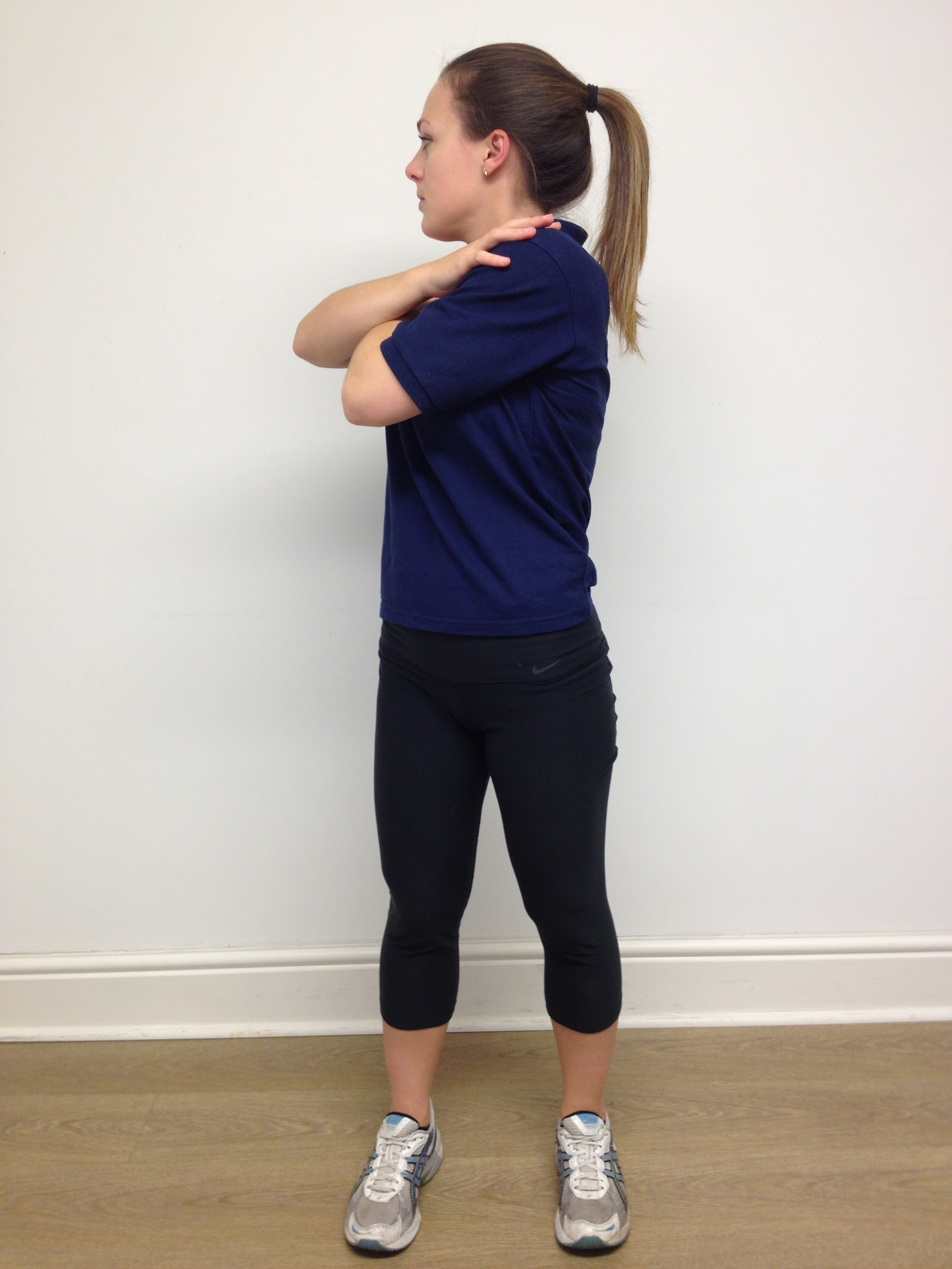 thoracic spine  mid-back  rotation stretch  standing